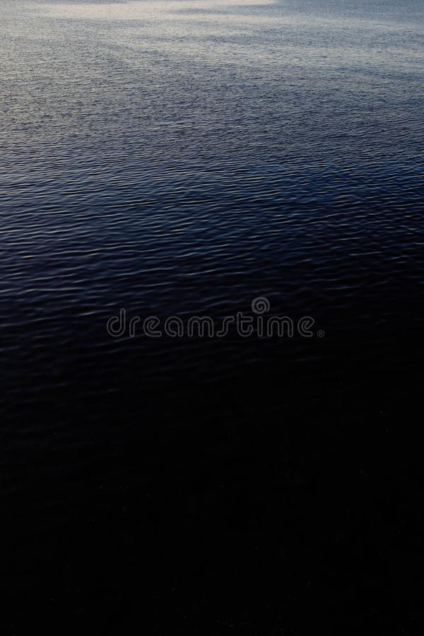 Vertical aerial shot of the surface of the calm ocean. A vertical aerial shot of the surface of the calm ocean stock photos
