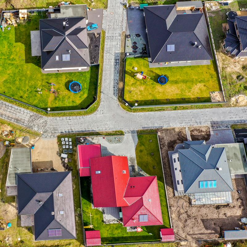 Vertical aerial view of a new housing estate with homes for families. Aerial stock photo