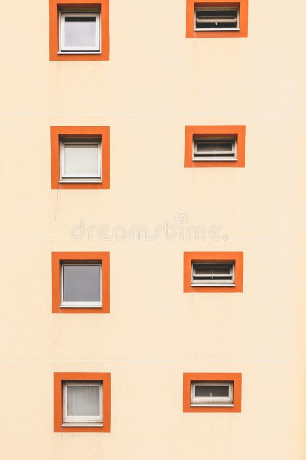 Vertical alignment of windows in an old building. Vertical alignment of square windows in an old residential building stock images