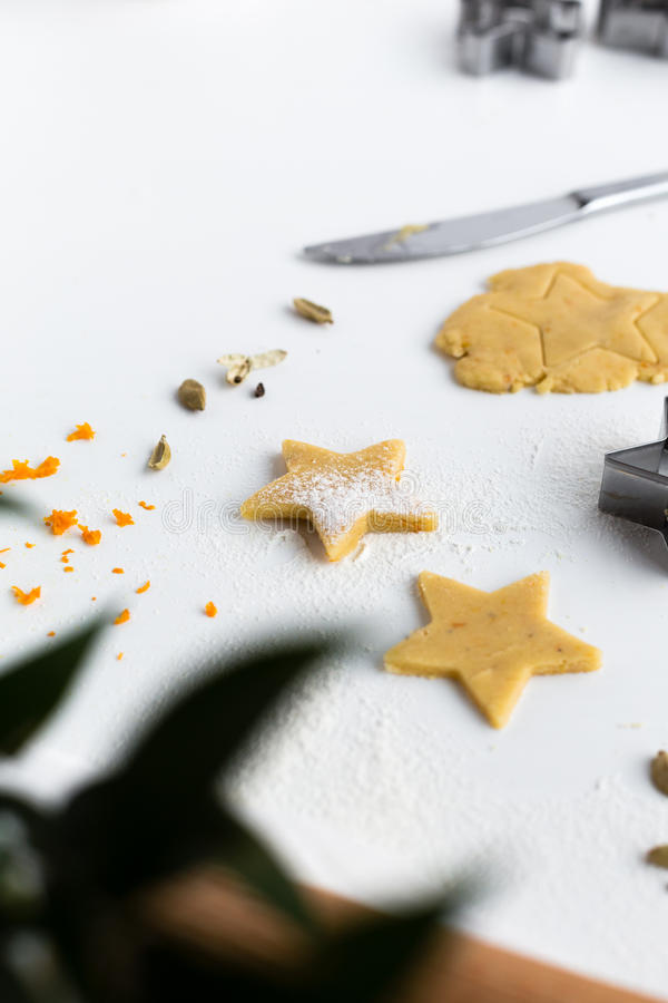 Download Vertical Baking Scene Of Orange And Cardamom Festive Star Biscuits On White Table Stock Photo - Image: 83720282