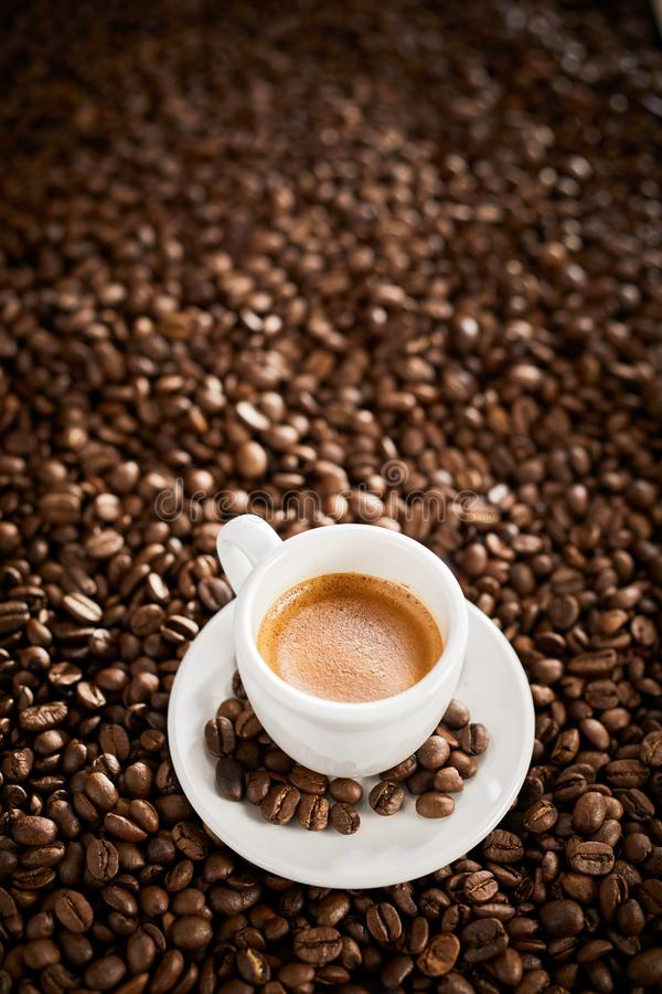 Vertical banner with espresso over coffee beans stock images