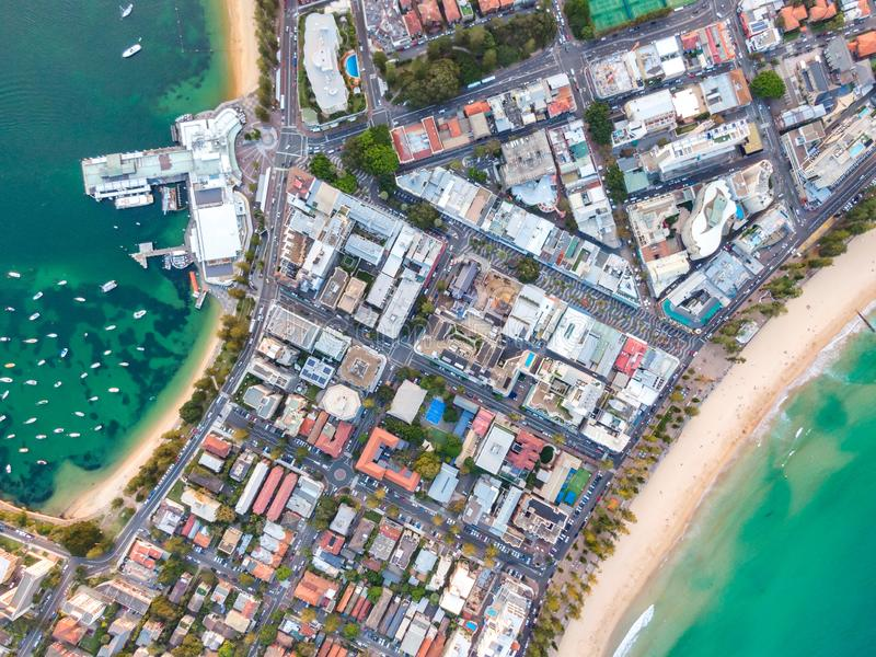 Vertical bird`s eye aerial drone panoramic view of the oceanside suburb of Manly, Sydney, New South Wales, Australia. Harbourside on the left, oceanside with royalty free stock photos