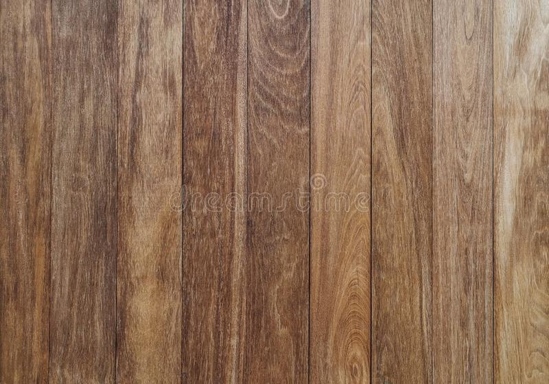 Vertical brown wood wall - Brown wood background, The walls of the brown wooden house were nailed in order to be beautiful. Abstract, backdrop, blank, board stock photo