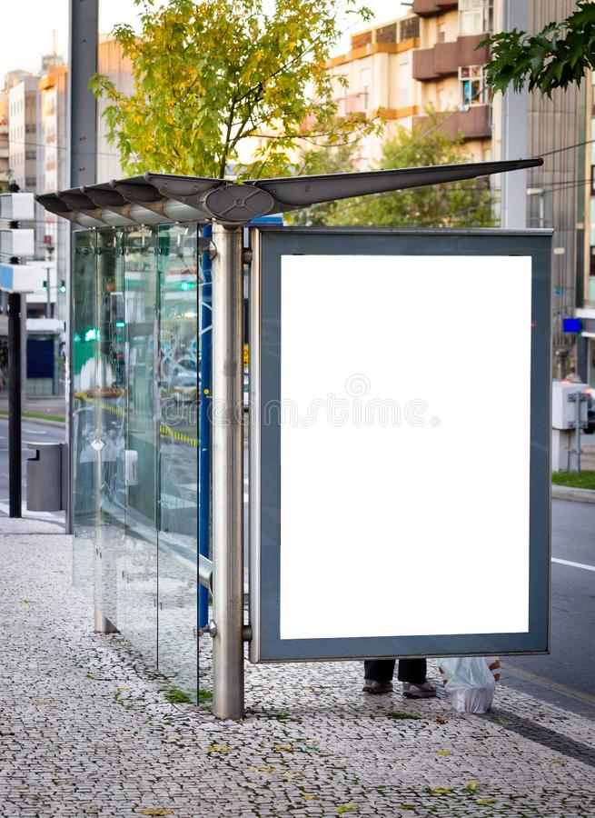 Vertical Bus Stop Advertisement Mockup. Street, Day. People Waiting. Copy Space.  royalty free stock photos