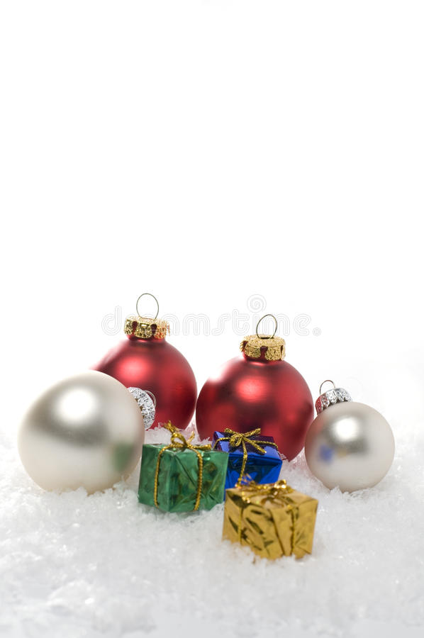 Vertical Christmas Ornaments on White Snow royalty free stock photography
