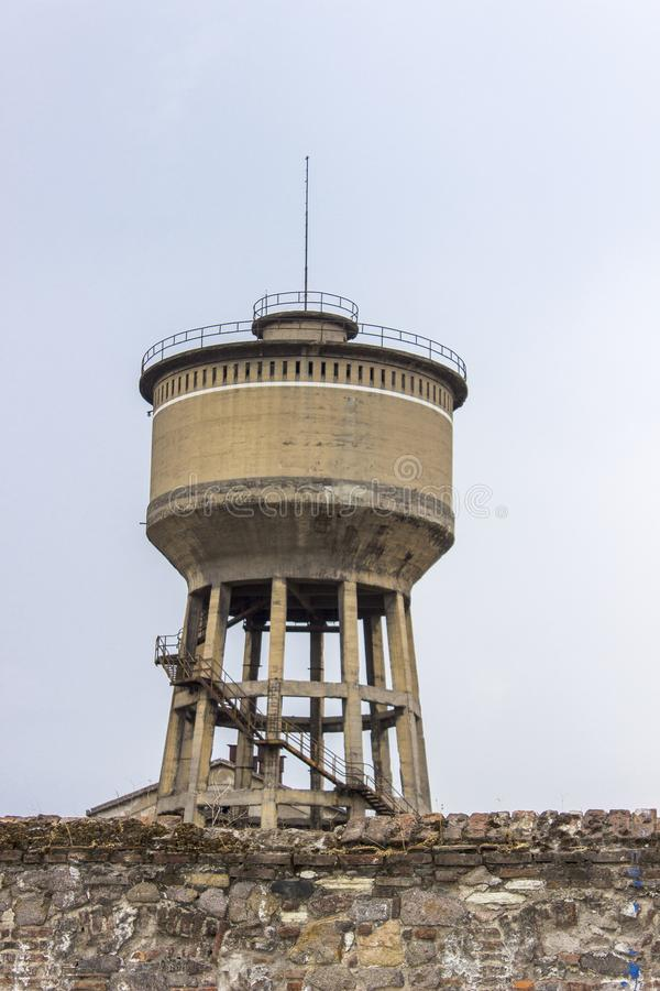 Vertical close-up shot of old reinforced pale yellow colored concrete water tank tower in Izmir at Turkey royalty free stock photos