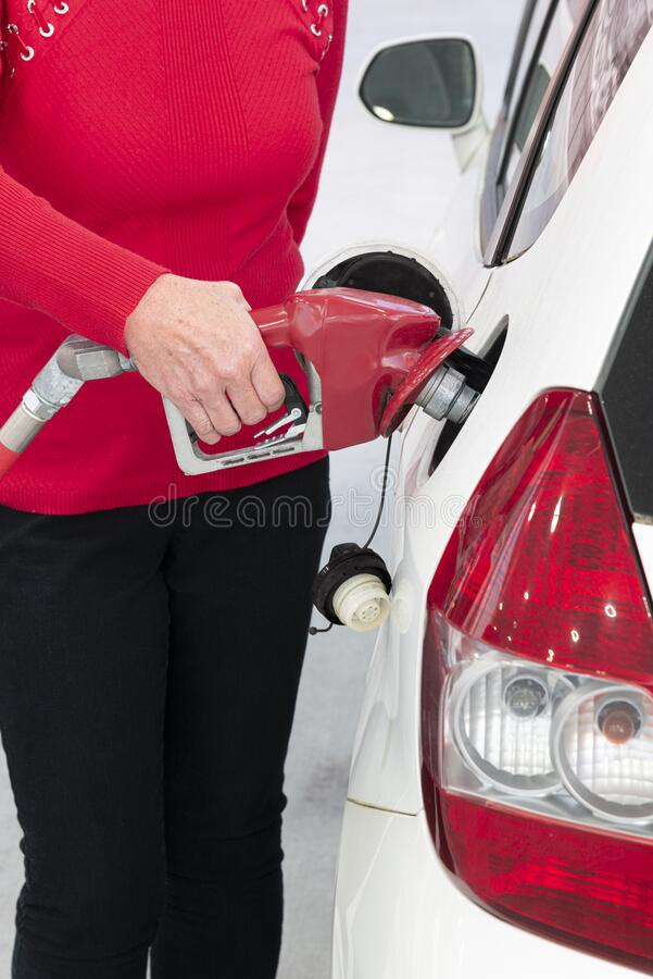 Woman Fueling Her Car stock images
