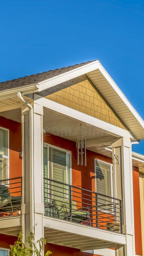 Vertical Close up of the small balcony of a home against clear blue sky on a sunny day royalty free stock photo