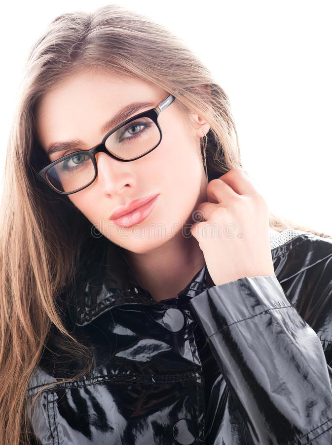 Vertical closeup portrait of beautiful young woman in black glasses royalty free stock photography