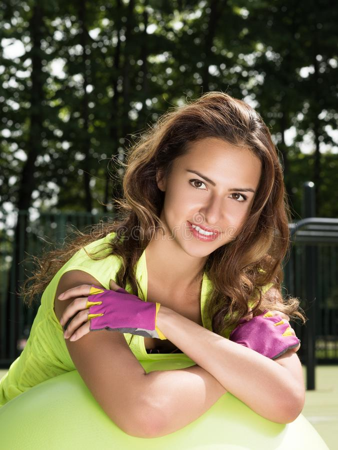 Vertical closeup portrait of a sporty young woman. Sporty look, purple gloves stock image