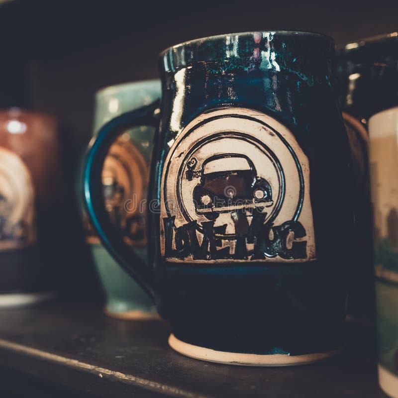 Vertical closeup shot of a ceramic blue beer mug. A vertical closeup shot of a ceramic blue beer mug stock images