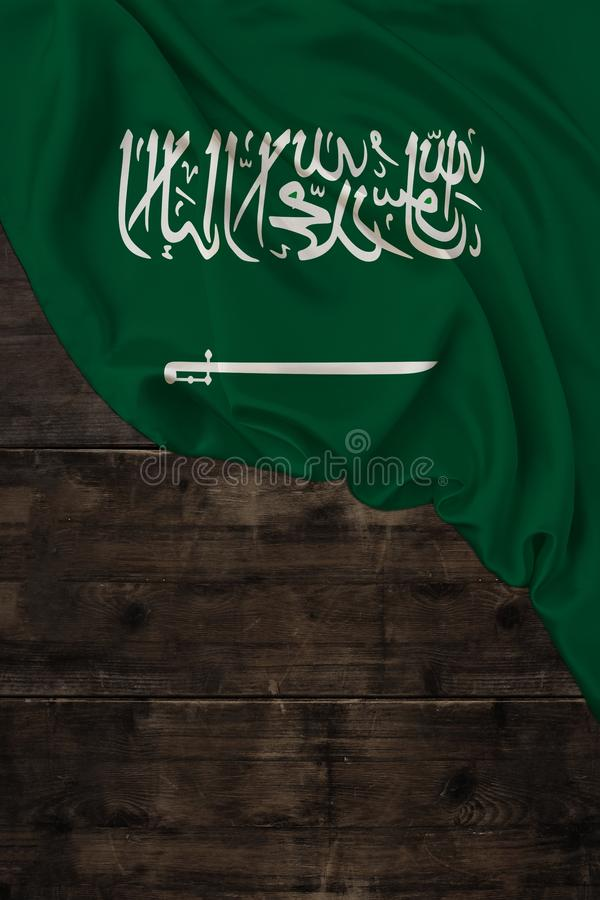 Vertical color national flag of modern state of Saudi Arabia, beautiful silk, old wood background, concept of tourism, economy,. Politics, emigration stock photos
