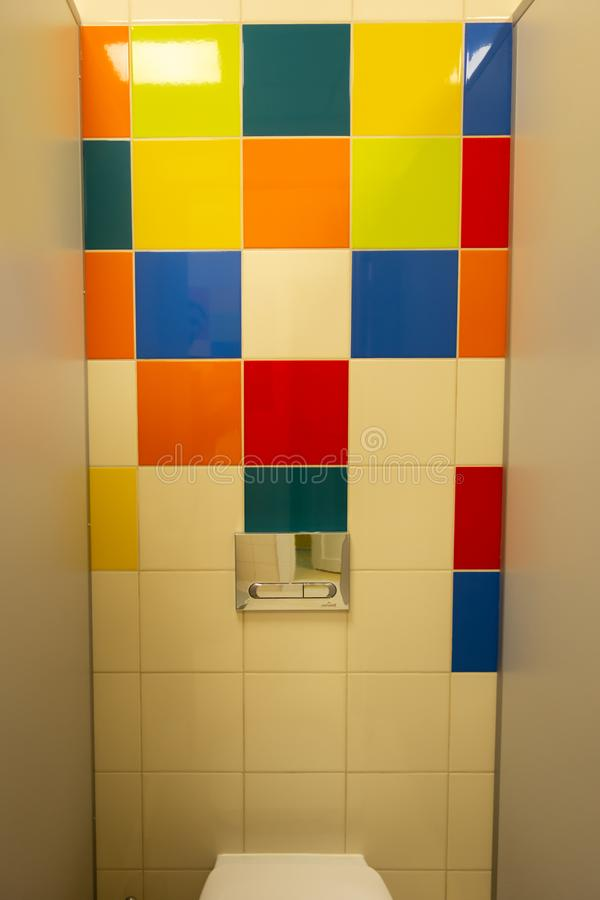 Vertical colorful tiling wall of the city. Creative colors for background or design. Beautiful combination of tiles of bright. Colors in a public toilet royalty free stock photography