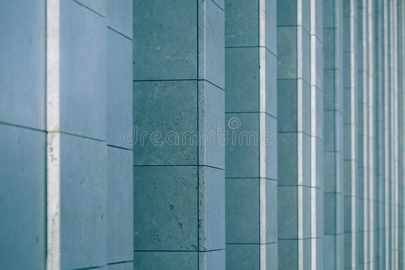 Vertical columns of the facade of a modern building as background royalty free stock photo