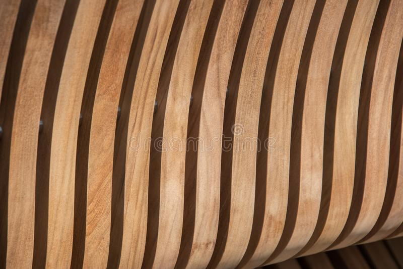 Vertical curved light colored wooden slat background. Vertical curved light colored wooden slat background royalty free stock images