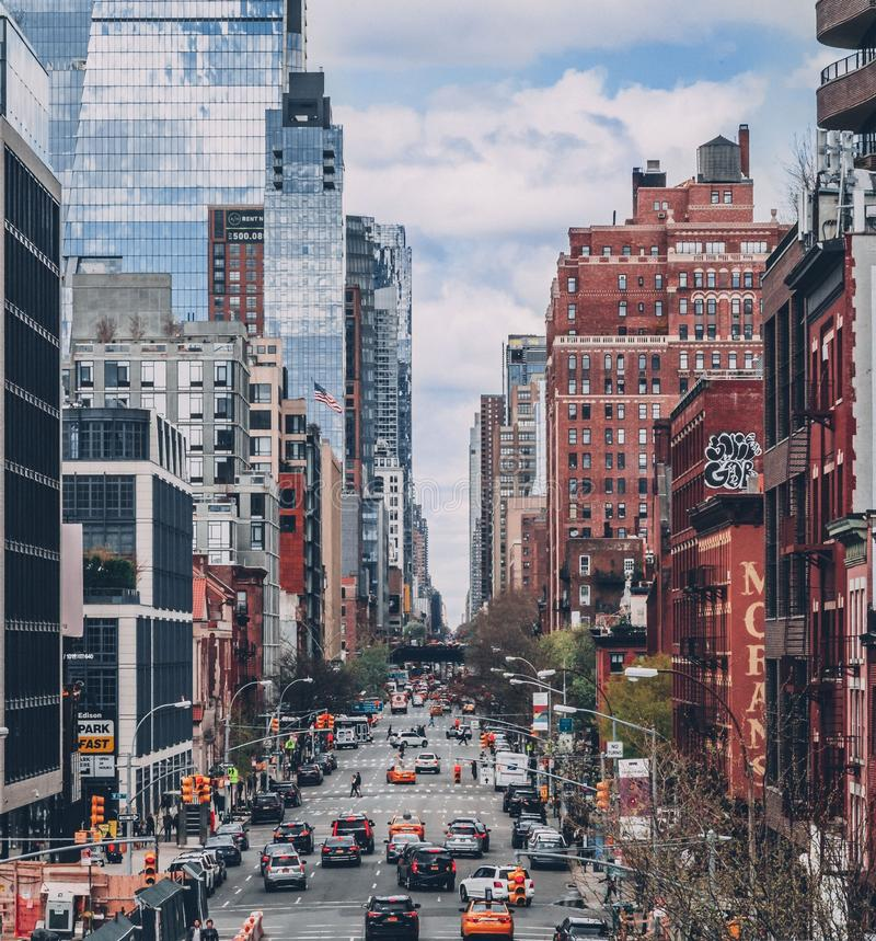 Vertical Distant Shot of High-Rise Buildings And Vehicle On The Roads Of A City. A Vertical Distant Shot of High-Rise Buildings And Vehicle On The Roads Of A stock photography