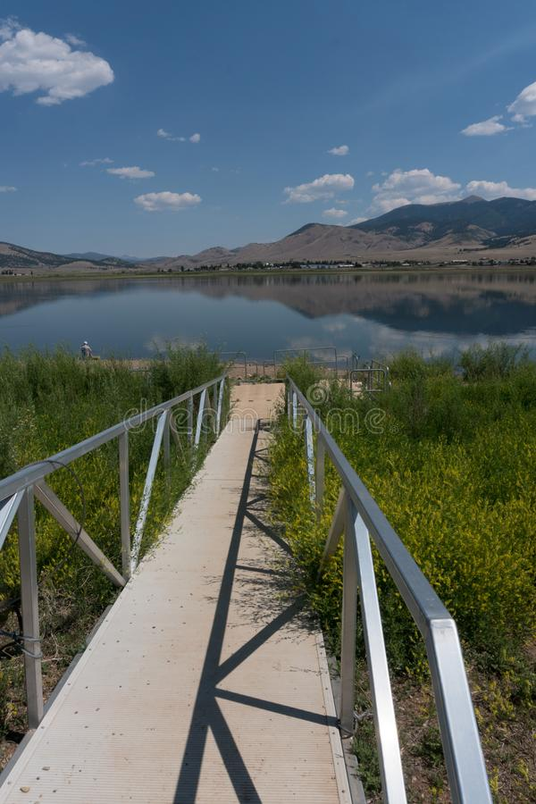 Vertical of Eagle Nest Lake dock in New Mexico. Eagle Nest Lake State Park in northern New Mexico is used by campers and fishermen a like royalty free stock photos