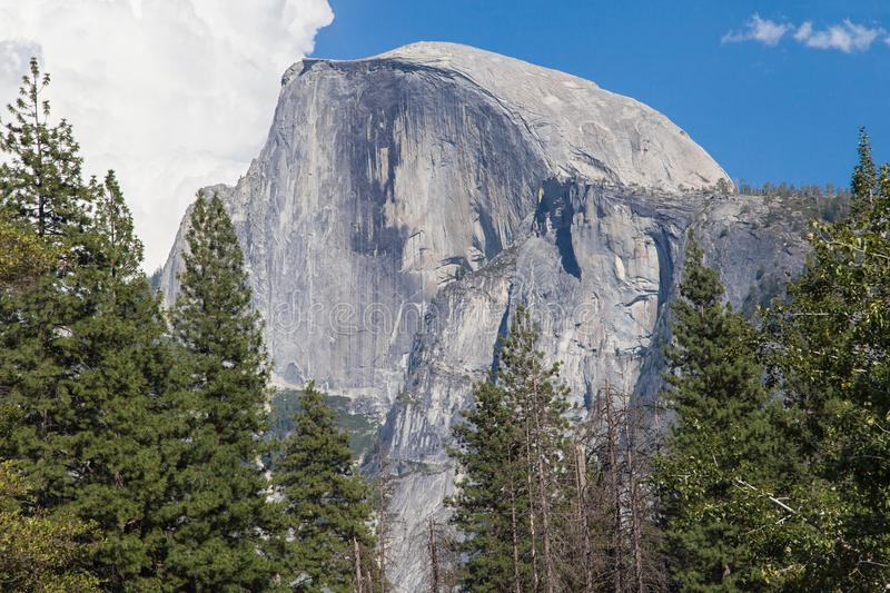 Vertical Face of the Half Dome. Close-up of the vertical face of the Half Dome seen from the Sentinel Bridge, Yosemite National Park, California, United States royalty free stock photos