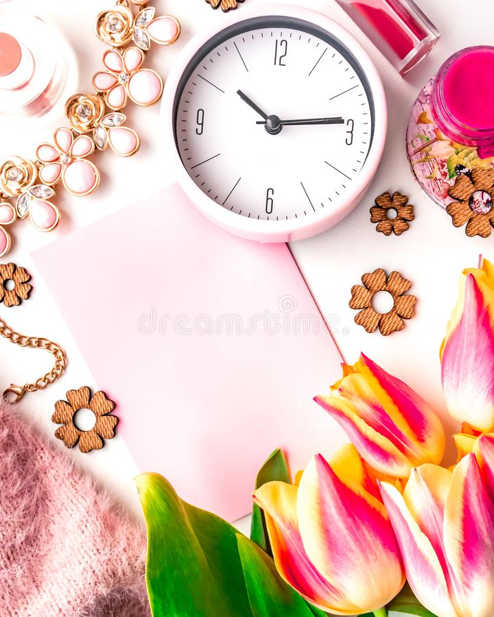 Vertical feminine flat lay with blank paper stock photos
