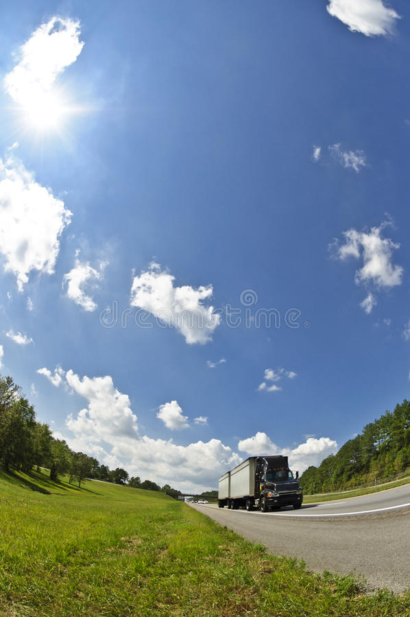 Vertical Fisheye Image of Semi Truck On Highway royalty free stock images