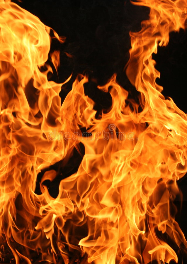 Vertical Flames. Closeup shot in detail of fire flames shot vertically. Black background royalty free stock photography