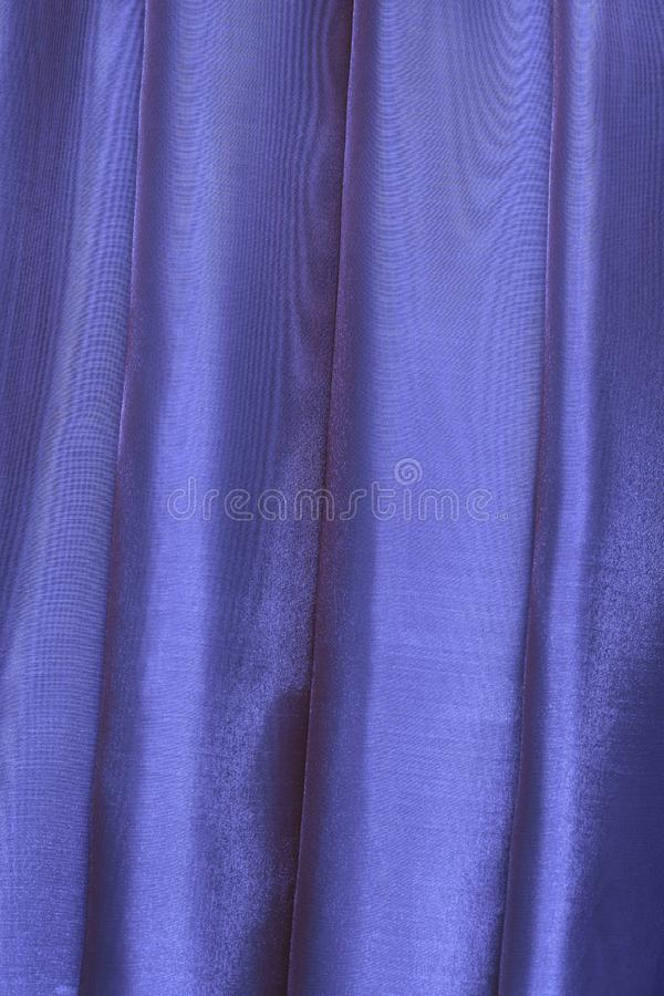 Vertical folds on blue organza curtains. For background and design royalty free stock photos