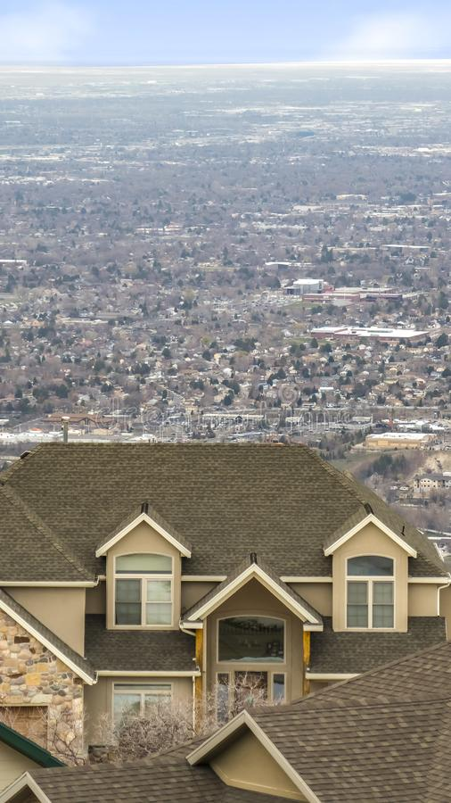 Vertical frame Aerial view of homes on a vast valley with the horizon and sky in the distance stock photos