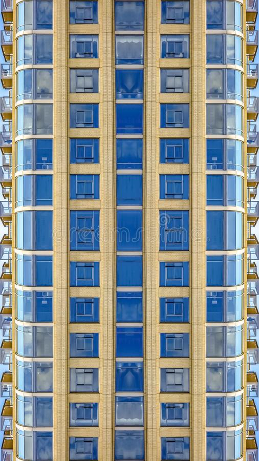 Vertical frame Apartment building in downtown Salt Lake City. Geometric kaleidoscope pattern on mirrored axis of symmetry reflection. Colorful shapes as a stock photo
