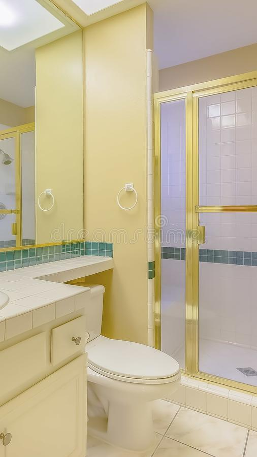 Vertical frame Bathroom interior of a house with green and gold accents stock photo