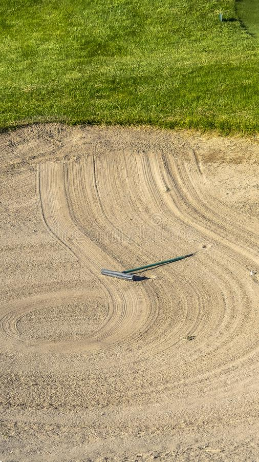 Vertical frame Close up of golf course sand bunker with a circular pattern created by the rake stock photos