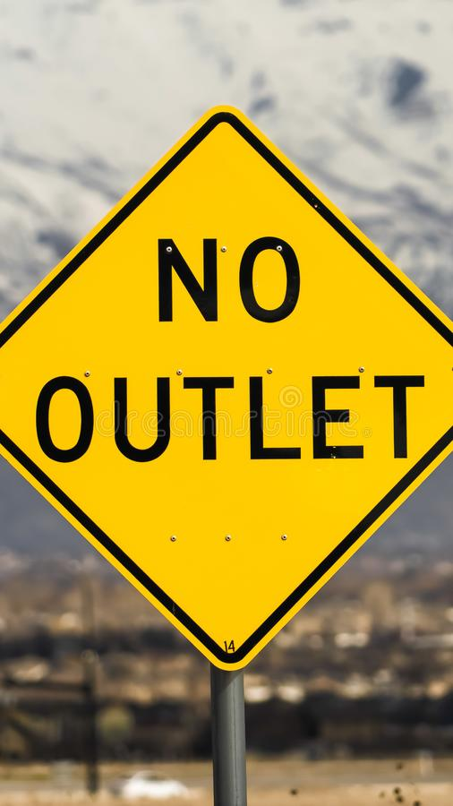 Vertical frame Close up view of a bright yellow and black No Outlet road sign stock image