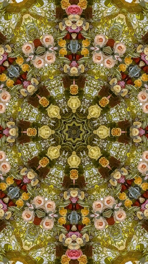 Vertical frame Colorful display of flowers in circular arrangement at wedding in California. Geometric kaleidoscope pattern on mirrored axis of symmetry stock photo