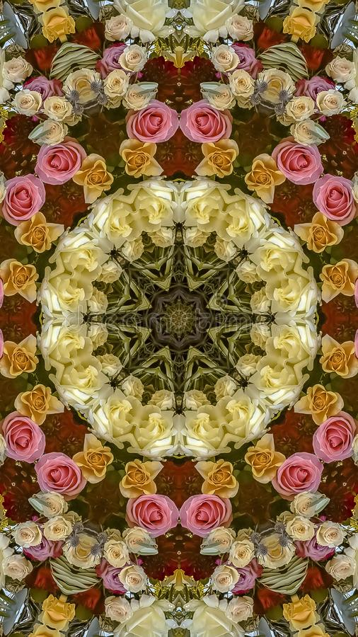 Vertical frame Design pattern made from pink yellow white orange roses at wedding. Geometric kaleidoscope pattern on mirrored axis of symmetry reflection stock photography