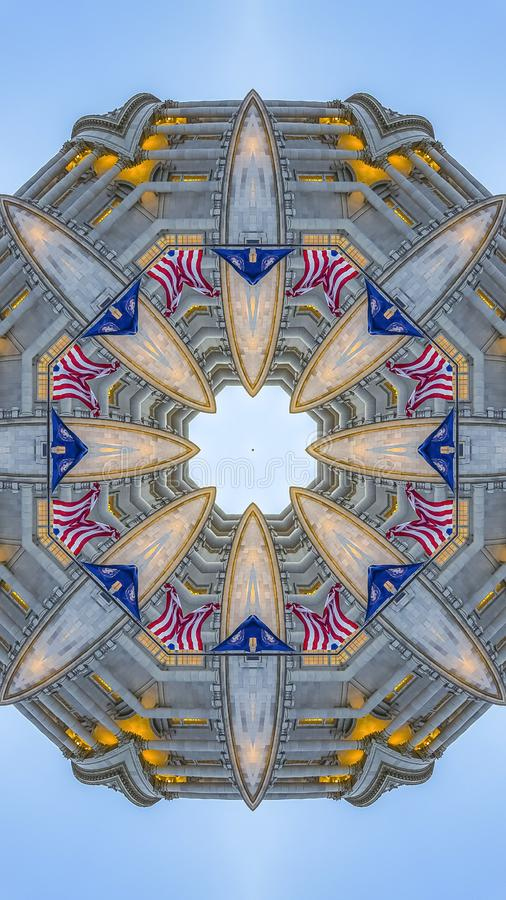 Vertical frame Emblem from the capital building and flags. Geometric kaleidoscope pattern on mirrored axis of symmetry reflection. Colorful shapes as a royalty free illustration