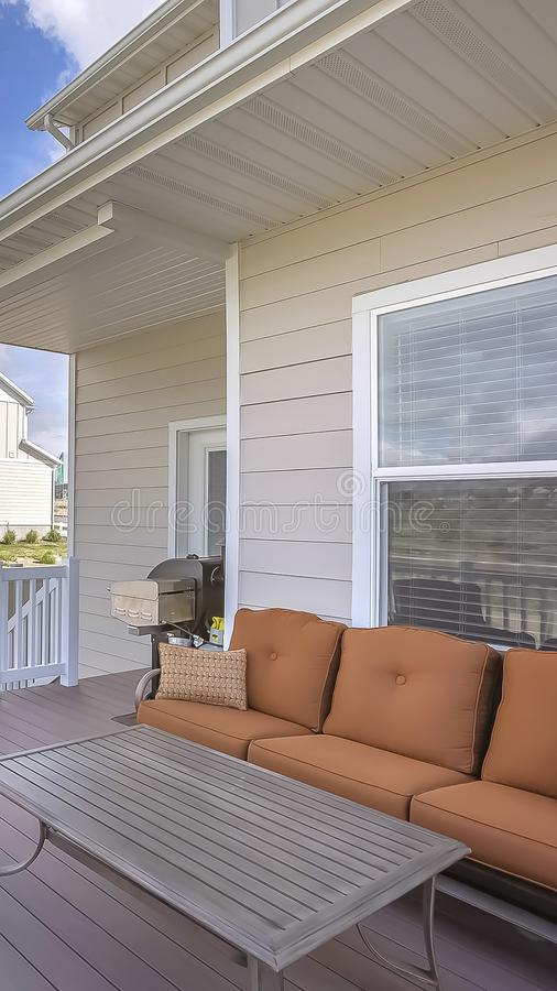 Vertical frame Exterior view of a home with seating area on the wooden deck stock photo