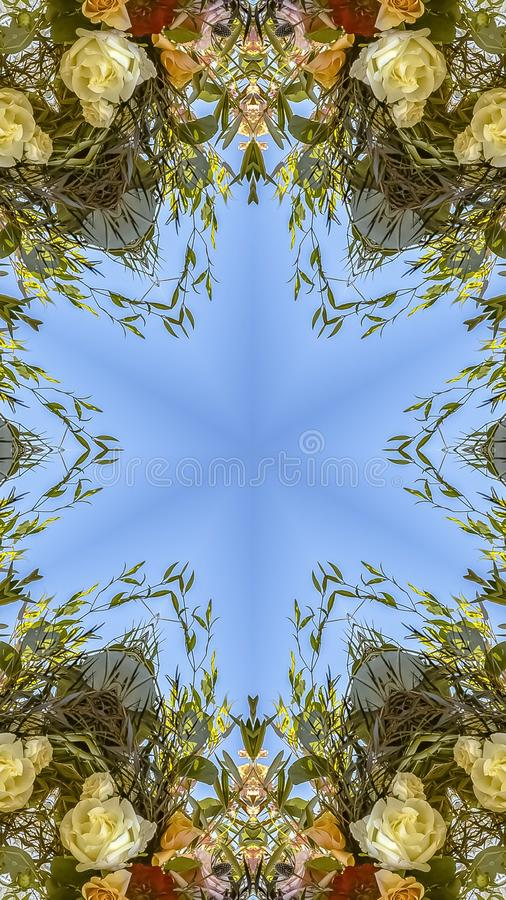 Vertical frame Floral design with interesting angles and colorful flowers. Geometric kaleidoscope pattern on mirrored axis of symmetry reflection. Colorful stock photos