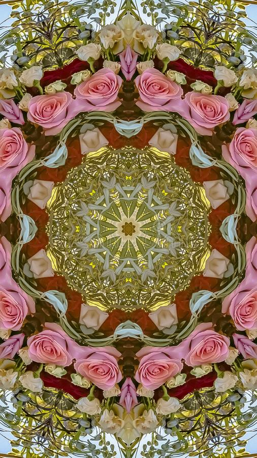 Vertical frame Roses of many colors made into a circular arrangement with green leaves in California wedding. Geometric kaleidoscope pattern on mirrored axis royalty free stock photography