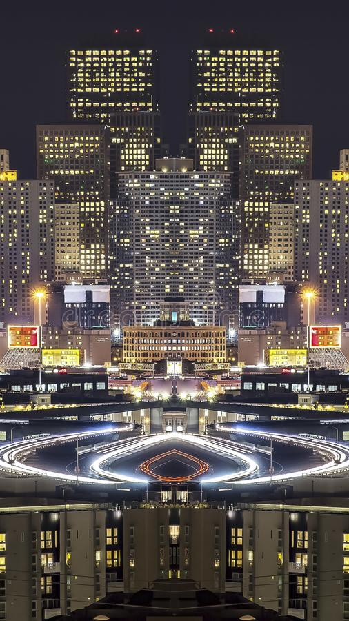 Vertical frame Skyline at night of San Francisco mirrored photo. Geometric kaleidoscope pattern on mirrored axis of symmetry reflection. Colorful shapes as a stock images