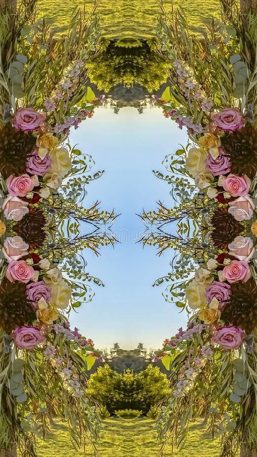 Vertical frame Symmetrical display of flowers in circular arrangement at wedding in California on Chuppah. Geometric kaleidoscope pattern on mirrored axis of royalty free illustration