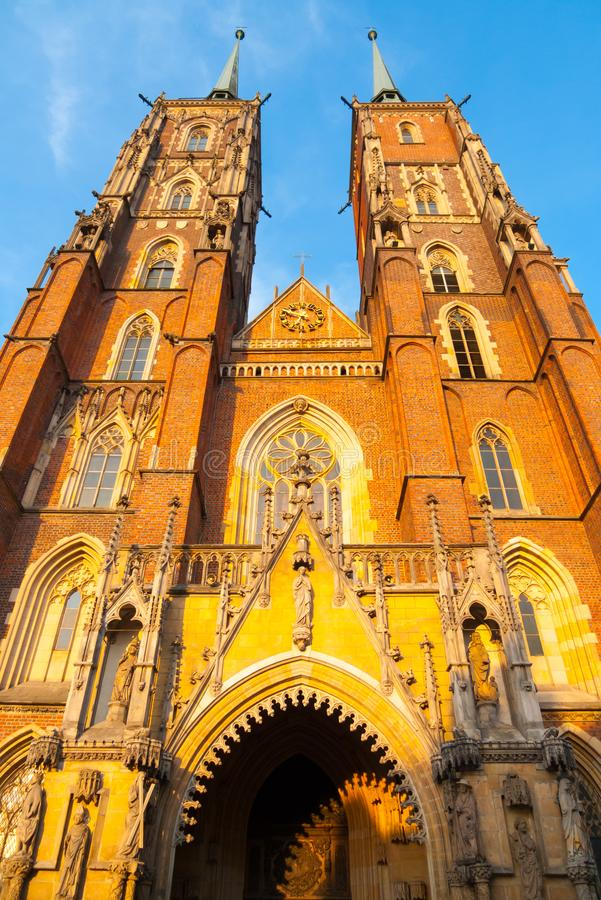 Vertical front view of St. John the Baptist cathedral at sunset royalty free stock photography