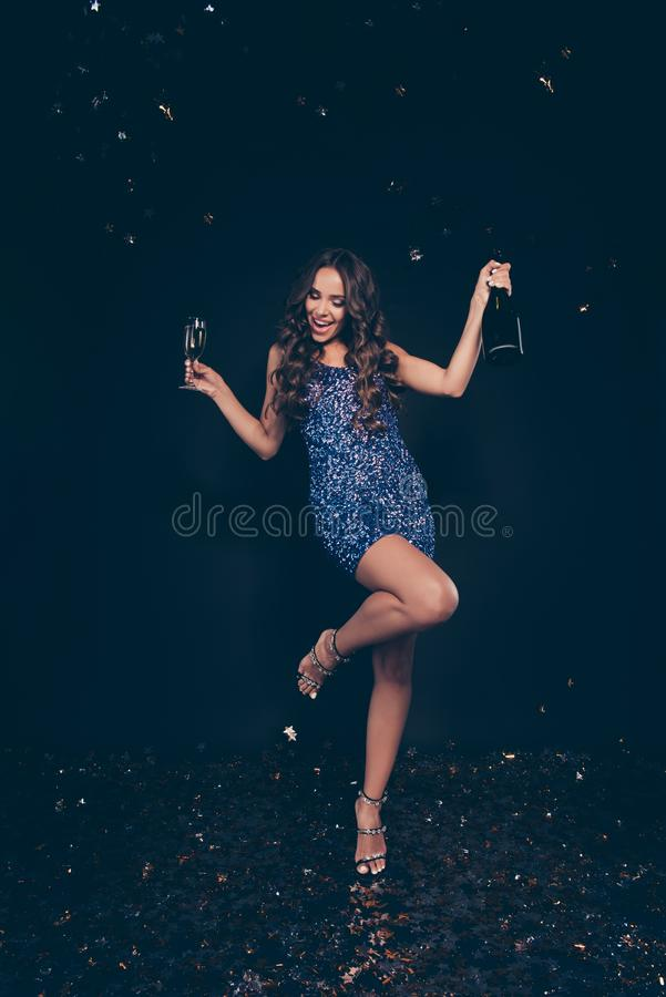 Vertical full length body size of diva cheerful cheery crazy sli. M graceful stunning charming attractive wavy-haired lady on high heels stilettos shoes bottle royalty free stock images