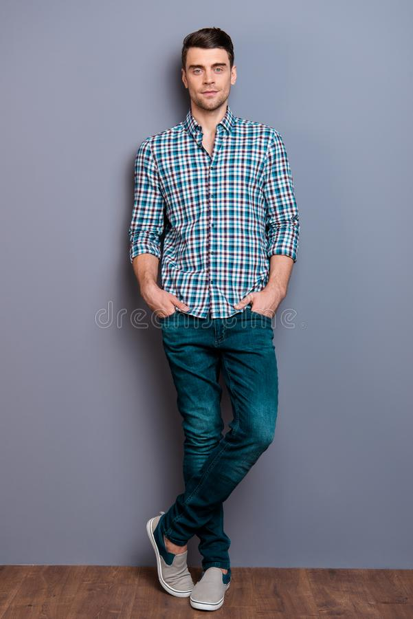 Vertical full length body size photo amazing he him his man arms hands pocket ideal perfect hairdo styling legs crossed. Wearing casual plaid checkered shirt stock photography