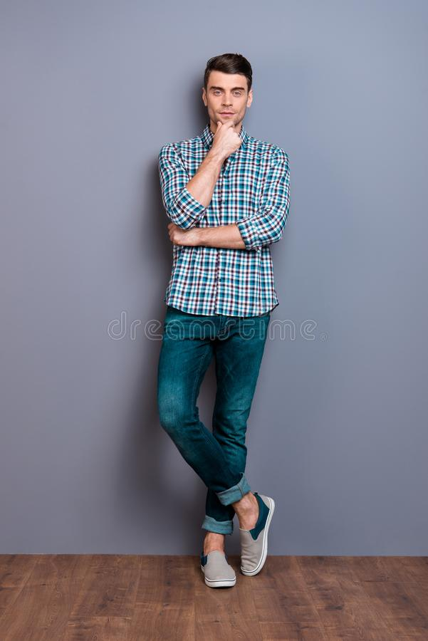 Vertical full length body size photo wondered he him his man arm hand chin perfect hairdo styling easy-going legs. Crossed wearing casual plaid checkered shirt royalty free stock photo