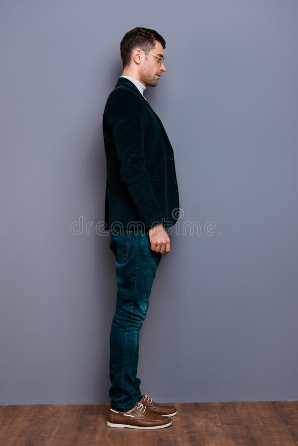 Vertical full length body size profile side view portrait of his he nice handsome attractive candid calm guy wearing. Velveteen blazer near over gray violet stock images