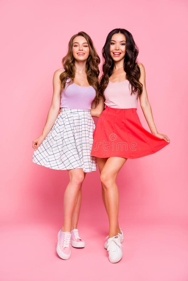 Vertical full length body size view of nice-looking charming lovely winsome fascinating adorable cheerful cheery girls. Vertical full length body size view of stock photos