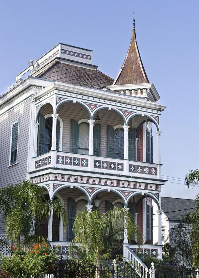 Vertical: Historic Victorian House in Gaveston, Texas. Historic three colored Victorian House in Galveston, Texas, ornate columns, porches, tiled roof, and royalty free stock photos