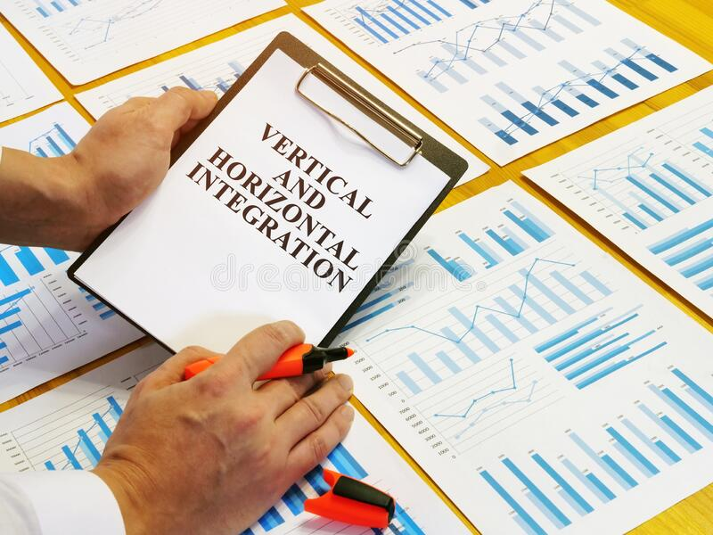 Vertical and horizontal integration strategy plan. Vertical and horizontal integration strategy plan in the office stock photos