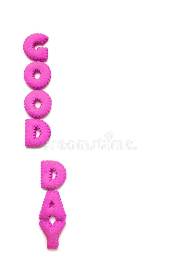 Vertical image of alphabet shaped cookies spelling the word GOOD DAY in vivid pink color. On white background royalty free stock photo
