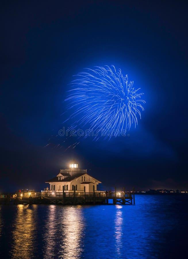 Fireworks Roanoke Marshes Lighthouse Manteo North Carolina. Vertical image of fireworks over the Roanoke Marshes Lighthouse on Shallowbag Bay in Manteo, North royalty free stock photography