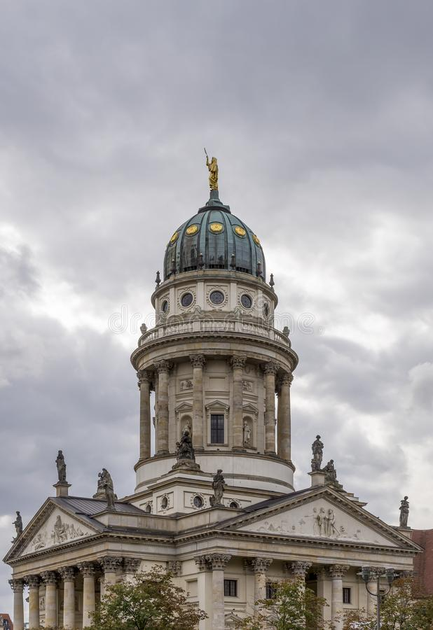 Vertical image of the Franzosischer Dom in the Gendarmenmarkt square, Berlin, Germany, on a typical winter day with cloudy skies stock photo